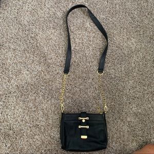 Black satchel with gold hardware